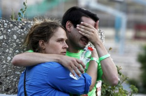 Participants of an annual gay pride parade react after an Orthodox Jewish assailant stabbed and injured six participants in Jerusalem on Thursday, police and witnesses said